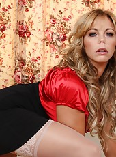 Classy slut Amber Lynn Bach playing with big boobs and posing in red lingerie