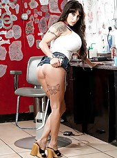 Gentle chick Deja Voo showing sexy tattooes and playing with her snatch