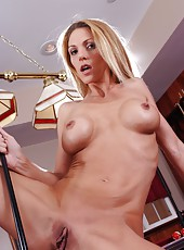 Elegant chick Roxanne Hall playing pool and masturbating on the table