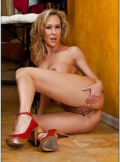 Skillful babe Brandi Love getting naked and masturbating in a hot solo action