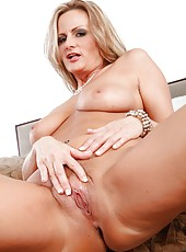 Charming milf Becca Blossoms showing awesome legs and playing with pussy