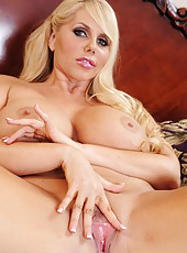 Busty blonde Milf Karen Fisher doing some hard masturbation of her pussy