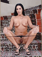 Sexy pornstar Veronica Rayne showing her lingerie and her hairy pussy