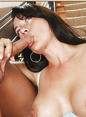 Excellent whore Sandy Beach making an awesome blowjob on the stairs