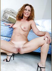 Marvelous mature Alex Nevada showing her skills in fingering pussy