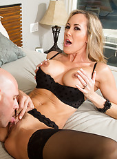 Exquisite milf Brandi Love is being pounded in her pussy by a bald guy