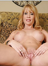 Divine bitch Desiree Dalton showing pink panties and rubbing big ass