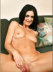 Raunchy brunette milf Lake Russell taking off her black underwear and posing