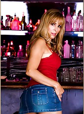 Ravishing hooker Nicole Moore posing on the table and showing ass