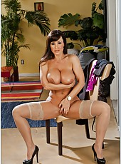 Busty slut Lisa Ann spreading trimmed vagina and fingering on the chair