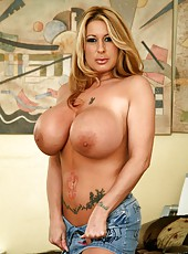 Busty milf Summer Sinn with her gigantic boobs and lovely tattoos posing