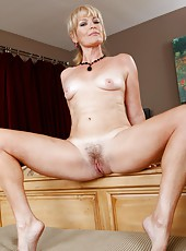 Lovely babe Tina Tosh stripping in high heels and spreading delicious pussy