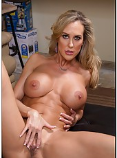 Spoiled bitch Brandi Love stripping in lingerie and licking naughty fingers