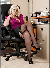 Rebellious pornstar Mandy Sweet posing in office and taking off lingerie
