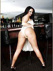 Entrancing beauty Maya Divine undressing and posing on the bar table
