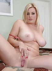 Busty blonde milf Kala Prettyman showing her big tits and masturbating