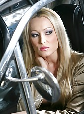 Glamorous blonde Diana Doll strips and fucks near her vintage car