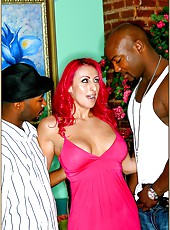 Naughty redhead cougar Raven Black is being raped by two hard black cocks