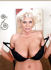 Busty blonde milf with huge tits Claudia Marie is posing for the cameras