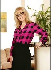 Engaging milf Nina Hartley teasing big tits and showing her shaved vagina