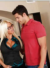 Tanned and busty blonde Nikita Von James plays with a big dick