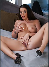 Beautiful brunette Melina Mason shows her great body and a shaved pussy