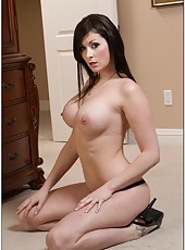 Passionate dark haired girl Sara Hide spreads her legs to show you her pussy