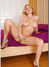 Gorgeous and busty blonde slut Krissy Lynn rubs her shaved hole and enjoys
