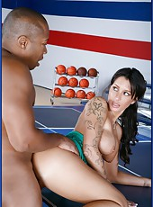 Ravishing brunette with big boobs Mya Nicole fights with big black man right on the ping-pong table
