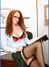 Curly-haired redhead Kitty Caulfield in sexy stockings banged by two cocks