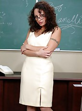 Mature wavy-haired busty teacher Mrs. Isabella Manelli seduces young excellent student