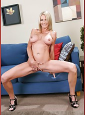 Horny and gorgeous milf Emma Starr is relaxing in her bedroom