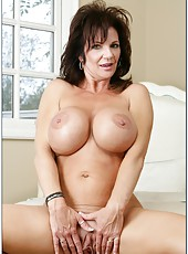 Gorgeous milf Mrs. Deauxma plays with her gentle pussy in the bedroom