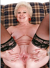 Hot and nasty granny Mrs. Jewell posing in stockings and fingering snatch