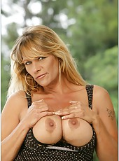 Happy bombshell Debi Diamond posing in hot lingerie and fingering outdoors