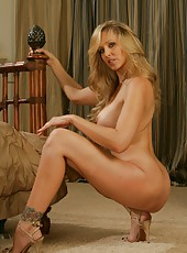 Stylish milf Julia Ann posing on the floor and getting naughty when masturbates