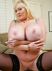 Dreamy babe Kayla Kleevage shows gigantic boobs and plays with pussy
