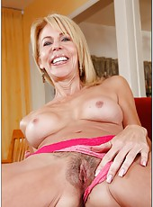 Posh mature Erica Lauren stripping like a young slut and fingering