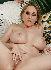 Fancy mature Raquel Sieb loves getting naked and masturbating all day long