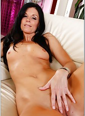Delicate pornstar with small tits India Summer posing and fingering on camera