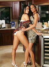 Playful philander Montana Skye teasing big tits right in the kitchen