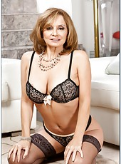 Charming mature Rebecca Bardoux posing in lingerie and jilling sissy
