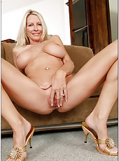 Staggering bitch Emma Starr posing almost naked and fingering vagina