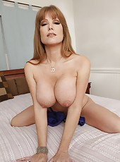 Winsome hooker Darla Crane loves posing naked and playing with her snatch