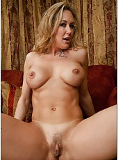 Lovely mature Brandi Love showing sexy body and fingering really hard