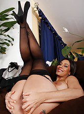 Sultry minx Raylene showing a sexy tattoo on her ass and masturbating