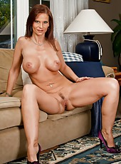 Bad girl Syren De Mer stripping on the sofa and making her pussy all wet