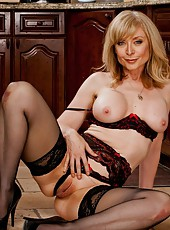 Goodly slut Nina Hartley posing in lingerie and playing with mature snatch
