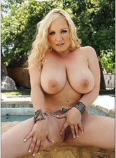 Marvelous bitch Rachel Love loves posing at the pool and shows big tits