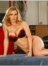 Stylish housewife Tanya Tate stripping in a hot dress and showing boobies
